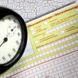 Überweisungsschein mit Blutdruck und Timer